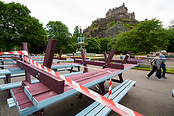 Edinburgh, Scotland, UK. 17 June, 2020. Views from Edinburgh city centre before expected relaxation of covid-19 lockdown by Scottish Government. Pictured; Outdoor seating and tables at Fountain Cafe in Princes Street Gardens remain closed . Iain Masterton/Alamy Live News