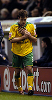 Photo: Jed Wee.<br /> Burnley v Norwich City. Coca Cola Championship. 24/03/2006.<br /> <br /> Norwich's Adam Drury leaves the game clutching his left wrist.