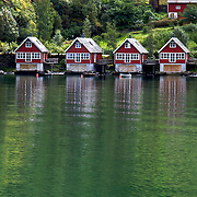 """The village of Flåm gets its name from Old Norse meaning """"little place between steep mountains."""" It is located in western Norway along the Aurlandsfjord, a tributary of the Sognefjord, the world's longest and deepest fjord."""
