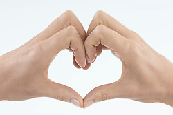 Close-up of woman's hands making heart shape, Bavaria, Germany