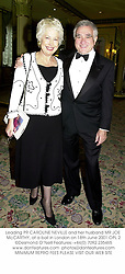 Leading PR CAROLINE NEVILLE and her husband MR JOE McCARTHY, at a ball in London on 18th June 2001.OPL 2