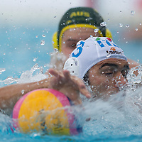 Niccolo Gitto (front) of Italy reasches for the ball during the Vodafone Waterpolo Cup in Budapest, Hungary on July 15, 2012. ATTILA VOLGYI