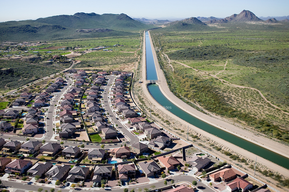 The Granite Reef Aqueduct, a man-made canal that has the carrying capacity of 1,800 cubic feet per second, diverts water from the Colorado River at Lake Havasu to central and southern Arizona.  This aqueduct is part of the 4-million-dollar Central Arizona Project designed to bring water into arid municipalities including Phoenix and Tuscon, and irrigate farmland in central Arizona.