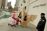 Cupid and performers on roller skates at Lincoln Center, outside the Mercedes-Benz Fall Fashion Week show on Valentine's Day.