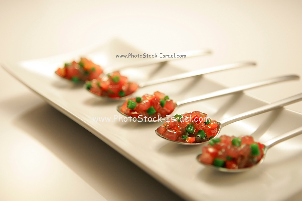 Spoons of tomato salad