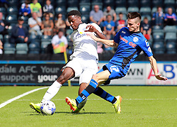 Peterborough United's Jermaine Anderson in action with Rochdale's Scott Tanser - Photo mandatory by-line: Joe Dent/JMP - Mobile: 07966 386802 09/08/2014 - SPORT - FOOTBALL - Rochdale - Spotland Stadium - Rochdale AFC v Peterborough United - Sky Bet League One - First game of the season