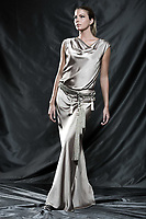Fashion pictures of a beautiful woman wearing cream satin cocktail sleeveless dress full length