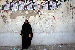 A relative holds a small martyr poster in her hand, Gaza, Palestinian Territories, Feb. 7, 2005. The Israeli military delivered the bodies of 15 dead militants, to the Palestinians for burial. A handover celebrated in Gaza as the first real achievement of leader Mahmoud Abbas, also known as Abu Mazen, who is trying to prevent militants from straying from a fragile truce.