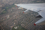 Window seat view of mid-Channel airliner wing and airspace over west London.