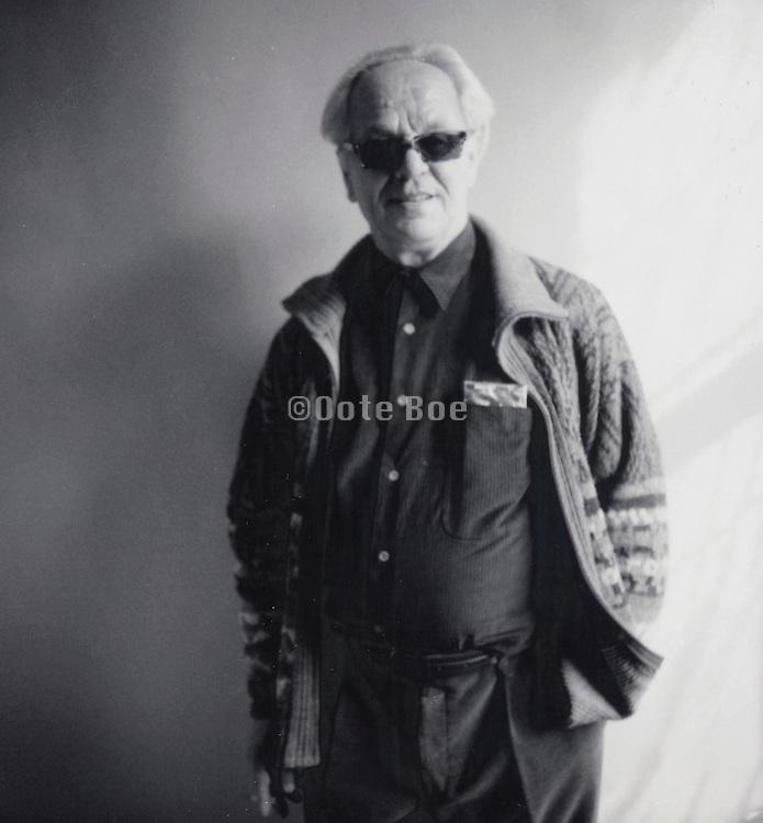 Elderly man posing assured for photograph