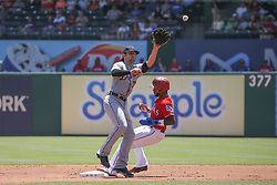 May 9, 2018 - Arlington, TX, U.S. - ARLINGTON, TX - MAY 09: Texas Rangers center fielder Delino DeShields (3) beats the throw to Detroit Tigers second baseman Pete Kozma (33) during the game between the Detroit Tigers and the Texas Rangers on May 9, 2018 at Globe Life Park in Arlington, TX. (Photo by George Walker/Icon Sportswire) (Credit Image: © George Walker/Icon SMI via ZUMA Press)