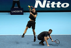 Bruno Soares (left) and Jamie Murray in action during their doubles match during day two of the NITTO ATP World Tour Finals at the O2 Arena, London.