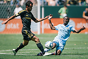 Los Angeles Galaxy midfield Juninho, left, is challenged by Manchester City midfielder Shaun Wright-Phillips during the second half of an friendly soccer match, Sunday, July 24, 2011, in Carson, Calif. (AP Photo/Bret Hartman)