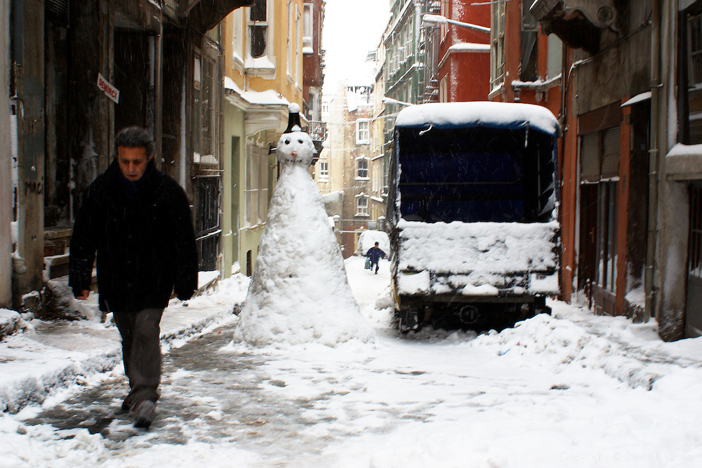 Sidestreet of Istanbul, near the main street in Beyoglu, Istanbul during a snow storm in Turkey.