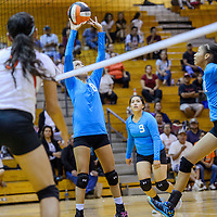 Navajo Prep Eagle Taina Sandoval (8) sets up a shot for teammate Martinique Larvingo (11) at the Gallup Bengals Wednesday at Gallup High School.