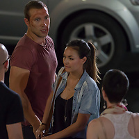Australian actor Jai Courtney (L) and his girlfriend Thai born Australian actress Gemma Pranita Xumsai (C) in the set during a break of his next movie fifth in the Die Hard series titled Good Day to Die Hard in Budapest, Hungary on July 11, 2012. ATTILA VOLGYI