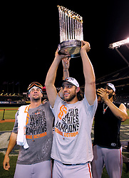 Madison Bumgarner celebrates with the trophy after Game 7 of the World Series, 2014 World Series Champion Giants