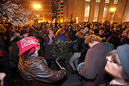 Boston, MA 12/09/2011.Occupy Boston protestors dance in Atlantic Avenue after learning that the polcie would not clear their campsite early Friday morning..Alex Jones / www.alexjonesphoto.com