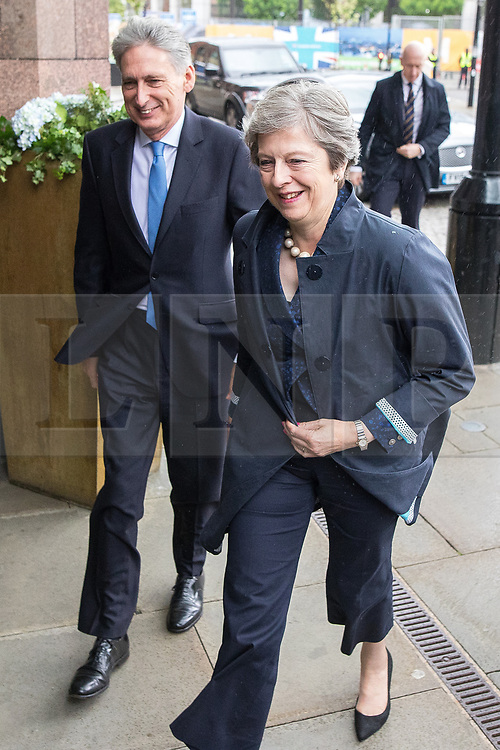 © Licensed to London News Pictures . 02/10/2017. Manchester, UK. PHILIP HAMMOND and THERSA MAY return from a visit in Manchester at the start of the second day of the Conservative Party Conference at the Manchester Central Convention Centre . Photo credit: Joel Goodman/LNP