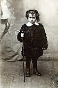 1900s studio portrait of a little boy dressed up as a shepherd
