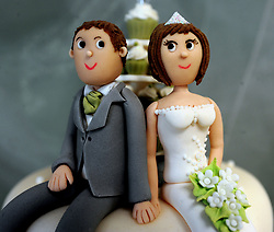 File photo dated 5/2/2013 of bride and groom cake decorations on a wedding cake. Marriage is good for heart health, a new study suggests.