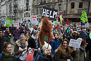 London, UK. Sunday 29th November 2015. Peoples March for Climate Justice and Jobs demonstration. Demonstrators gathered in their tens of thousands to protest against all kinds of environmental issues such as fracking, clean air, and alternative energies, prior to Major climate change talks.