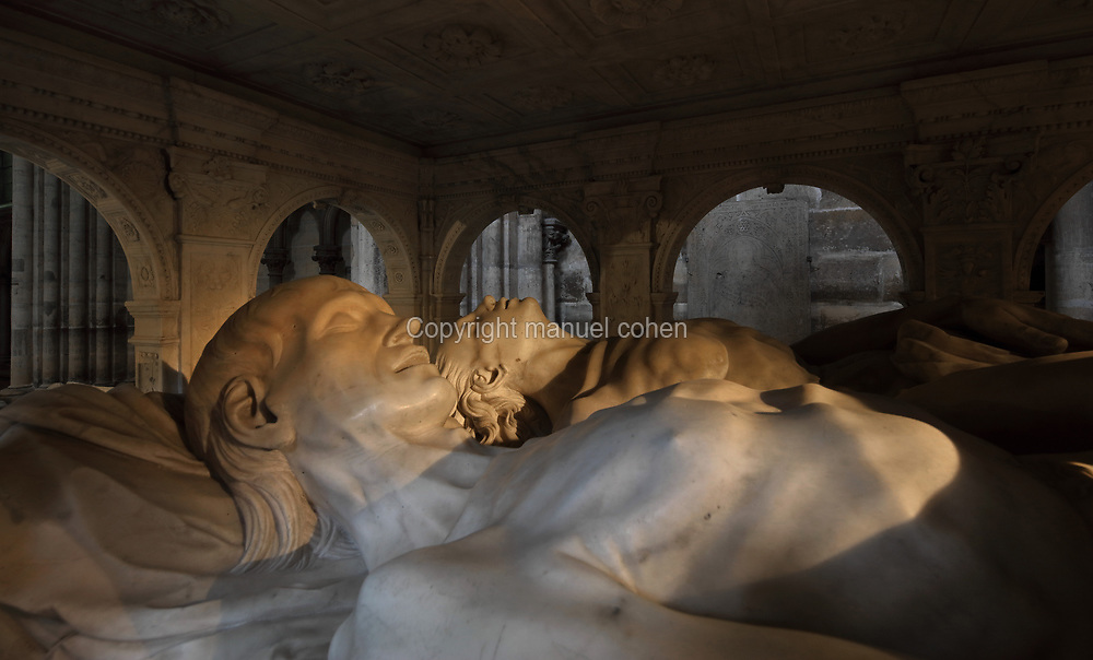 Effigies, detail from the funerary monument of Louis XII, 1462-1515, and Anne of Brittany, 1477-1514, made 1516-31 in Carrara marble by Giovani di Giusto Betti, 1479-1519, in the Basilique Saint-Denis, Paris, France. The mausoleum resembles an antique temple and is surrounded by the 12 apostles and the 4 cardinal virtues, Prudence, Might, Justice and Temperance and the plinth is decorated with bas-reliefs of the Italian wars. The basilica is a large medieval 12th century Gothic abbey church and burial site of French kings from 10th - 18th centuries. Picture by Manuel Cohen