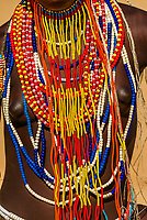 Young women wearing beaded necklaces, Arbore tribe village, Omo Valley, Ethiopia.