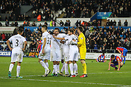 Swansea City players celebrate after the final whistle. Premier League match between Swansea City and Crystal Palace at the Liberty Stadium, Swansea, Wales on 26 November 2016. Photo by Andrew Lewis.