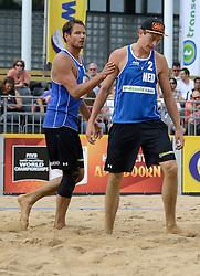 16-07-2014 NED: FIVB Grand Slam Beach Volleybal, Apeldoorn<br /> Poule fase groep A mannen - Reinder Nummerdor (1), Steven van de Velde (2) NED