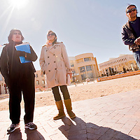 022313       Cable Hoover<br /> <br /> Erika Casuse, left, and Ursula Casuse-Carrillo speak at a memorial for their brother, Larry Casuse, at the McKinley County Courthouse Plaza in Gallup Saturday.
