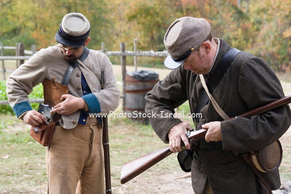 Arkansas, AR, USA, Old Washington State Park, Civil War Weekend. Confederate soldiers preparing for battle,