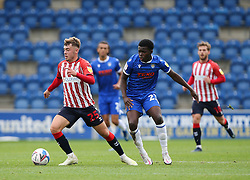 Alfie McCalmont of Oldham Athletic on the ball under pressure from Kwame Poku of Colchester United - Mandatory by-line: Arron Gent/JMP - 03/10/2020 - FOOTBALL - JobServe Community Stadium - Colchester, England - Colchester United v Oldham Athletic - Sky Bet League Two