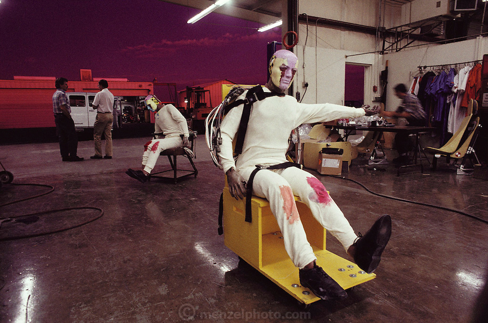 Failure Analysis Associates, Inc. (an engineering and scientific consulting firm now called Exponent)..After crash test. Dummies grease painted to show impact parts on car interior.