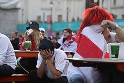 © Licensed to London News Pictures. 07/07/2021. London, UK. England fans react to going 1-0 down. England fans gather at the Fan Zone in Trafalgar Square, central London, for the Euro 2020 semi final between England and Denmark. England are attempting to reach their first final since 1966. Photo credit: Ben Cawthra/LNP