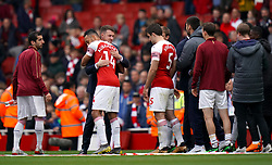 Arsenal's Aaron Ramsey says goodbye to team mate Arsenal's Pierre-Emerick Aubameyang on the pitch after the final whistle of the Premier League match at the Emirates Stadium, London.