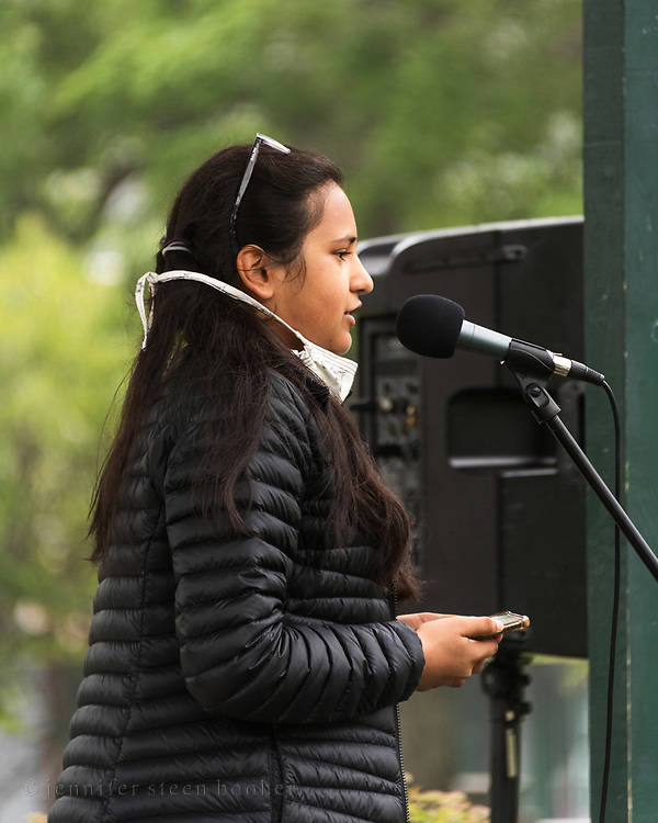 Bar Harbor, Maine, USA. 21 June, 2020. Sirohi Kumar, a student at Mount Desert Island High School addresses the crowd at the MDI March and Rally In Solidarity with Black Lives Matter. Ms. Kumar is one of the march organizers.