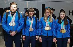ParalympicsGB medalists' Millie Knight (second left) and guide Brett Wild (left) with Menna Fitzpatrick (right) and her guide Jennifer Kehoe (second right) pose for a photo as the team arrive at Heathrow Airport, London, following the PyeongChang 2018 Winter Paralympics.