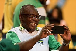 JOHANNESBURG, Dec. 18, 2017  Cyril Ramaphosa takes photos before the announcement of results at South Africa's ruling party African National Congress' conference in Johannesburg, South Africa, on Dec. 18, 2017. South Africa's ruling party African National Congress (ANC) elected Cyril Ramaphosa on Monday to be the party's president for the next five years. (Credit Image: © Dave Naicker/Xinhua via ZUMA Wire)