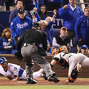 Kansas City Royals second baseman Omar Infante scores from Kansas City Royals shortstop Alcides Escobar double in the fifth inning against San Francisco Giants catcher Buster Posey in Game 6 of the World Series on Tuesday, October 28, 2014 at Kauffman Stadium in Kansas City, Mo.