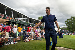 May 5, 2019 - Charlotte, North Carolina, United States of America - Justin Rose tosses his glove to a young fan while exiting the eighteenth green after finishing his round during the final round of the 2019 Wells Fargo Championship at Quail Hollow Club on May 05, 2019 in Charlotte, North Carolina. (Credit Image: © Spencer Lee/ZUMA Wire)