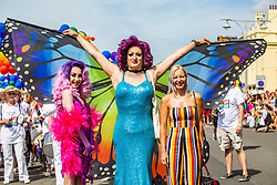 © Licensed to London News Pictures. 04/08/2016. Brighton, UK. Teenage Drag queen ATHENA HEART, aka LEWIS BAYLEY joins MARTHA D'ARTHUR, aka TOM JENKINS at the head of the Brighton Pride Parade 2018. LEWIS was banned by Castle High School anVisual Arts College to perform as Athena at the End of year talent show. The decision has caused widespread anger from LGBTQ community support groups. Photo credit: Hugo Michiels/LNP