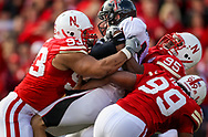 Ndamukong Suh (93), Pierre Allen (95) and Barry Turner (99) team up n a tackle against Texas Tech on Oct. 17, 2009. © Aaron Babcock