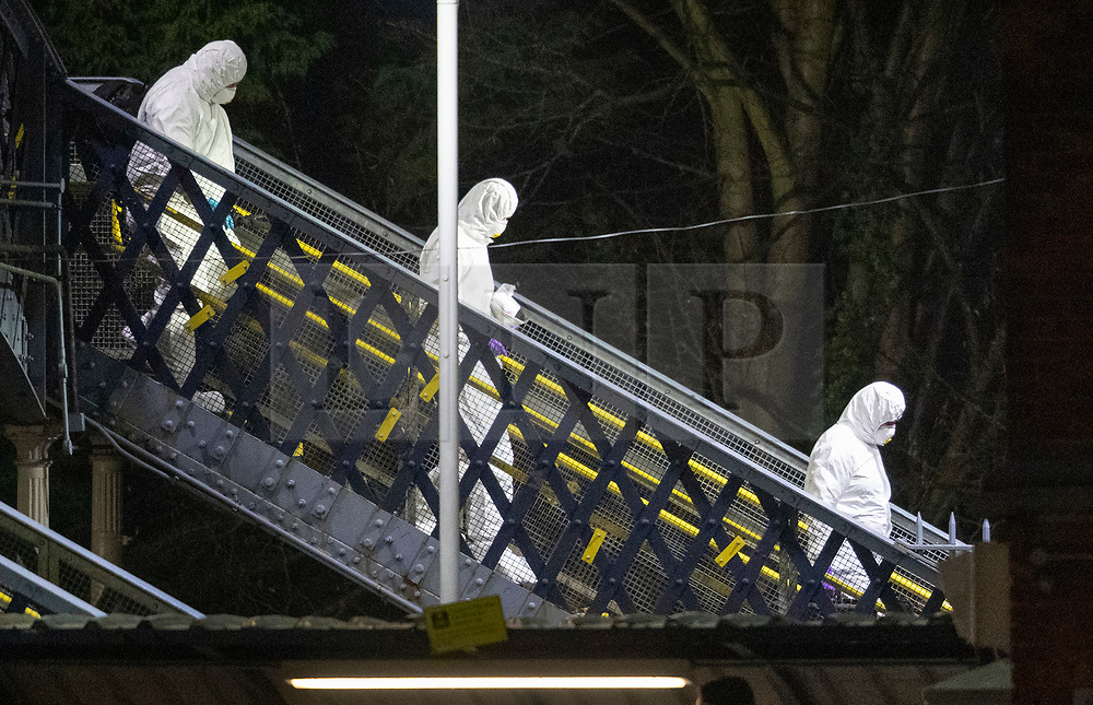 © Licensed to London News Pictures. 04/01/2019. Horsley, UK. Forensics cross the footbridge at Horsley Railway station in Surrey where a man has been stabbed to death on a train. A murder investigation has been launched after the man was attacked while on board the 12. 58pm train service travelling between Guildford and London Waterloo. . Photo credit: Peter Macdiarmid/LNP