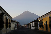Volcan de Agua, the Volcano of Water, 3766m, dominates views to the south of Antigua Guatemala. Here it is the background to 5 Avenida Sur. Antigua Guatemala, Republic of Guatemala. 02Mar14