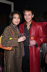 Society figures MR & MRS ANDY WONG, at a party in London on 7th November 2000.OIT 51