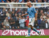 Photo: Daniel Hambury.<br /> Manchester City v West Bromich Albion. Barclaycard Premiership. 13/08/2005.<br /> Manchester City's Danny Mills lets his feelings  be known to the linesman.