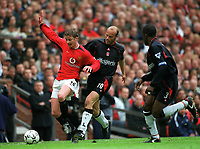 Ole Gunnar Solskjaer (Manchester United) tackled by Claus Jensen (Charlton) Manchester United v Charlton Athletic, FA Premiership, 3/05/2003. Credit: Colorsport / Matthew Impey