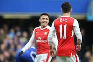 Alexis Sanchez of Arsenal talking to Mesut Ozil of Arsenal. Premier league match, Chelsea v Arsenal at Stamford Bridge in London on Saturday 4th February 2017.<br /> pic by John Patrick Fletcher, Andrew Orchard sports photography.
