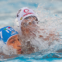 Matteo Aicardi (L) of Italy fights against Tamas Varga (R) of Hungary during the Vodafone Waterpolo Cup in Budapest, Hungary on July 16, 2012. ATTILA VOLGYI